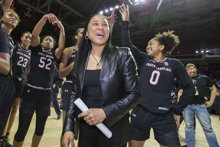 South Carolina coach Dawn Staley and her team celebrate after their victory over Temple.