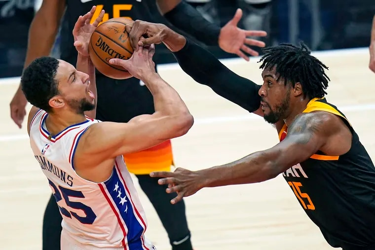 Utah Jazz center Derrick Favors defends against the 76ers' Ben Simmons in the first half.