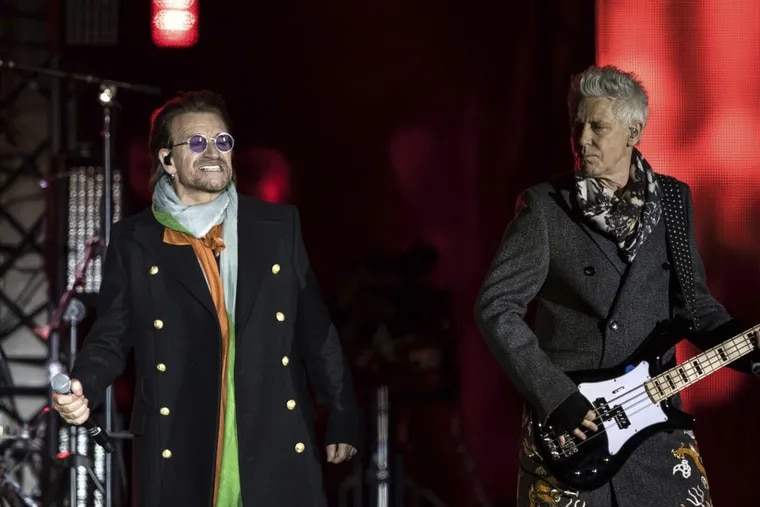 Singer Bono, left, and Adam Clayton, from the band U2 perform on stage in Trafalgar Square ahead of the 2017 MTV Europe Music Awards, in London, Saturday, Nov. 11, 2017. (Photo by Vianney Le Caer/Invision/AP)