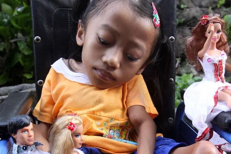 Stitching intricate outfits for Barbie dolls gives disabled Putu Restiti, 21, above, and her sister Alit Astini, 11, an income and friends.
