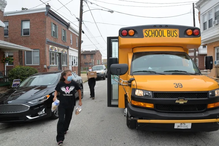 Joanne Coskey, a Ridley School District kitchen staffer and bus aide, rides a district bus that delivers breakfast and lunch to the homes of students and families in need five days a week.