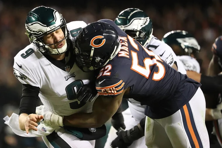 We've seen this before: Khalil Mack lowers the boom on Eagles quarterback Nick Foles during last year's playoff game in Chicago.