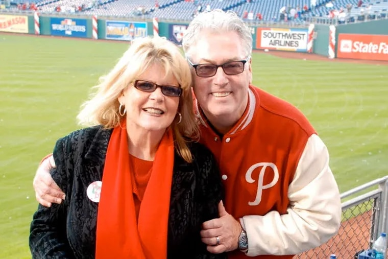 Edward Gudonis, known to WIP listeners as Big Daddy Graham, and his wife Debbie celebrate the Phillies 2008 World Series championship at Citizens Bank Park. Graham died Wednesday night.
