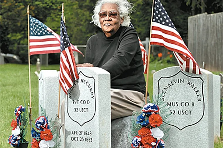 Catherine Tucker was instrumental in securing new grave markers for seven African American Civil War veterans buried at Bethel A.M.E. Church in Marietta, Pa. (Clem Murray/Inquirer)