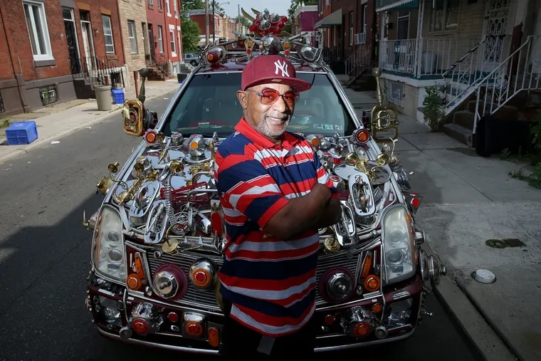 Gilbert Hilton decorates his 2004 Cadillac SRX with items he purchases at Goodwill.