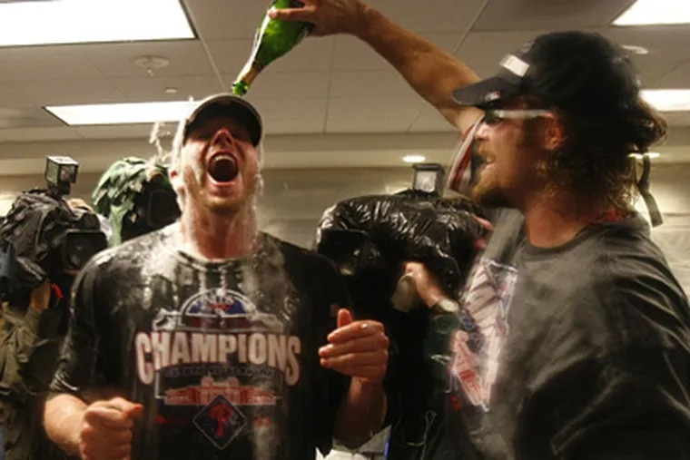 Roy Halladay gets a champagne bath courtesy of Jayson Werth after the Phillies clinched the NL East title. (Ron Cortes / Staff Photographer)