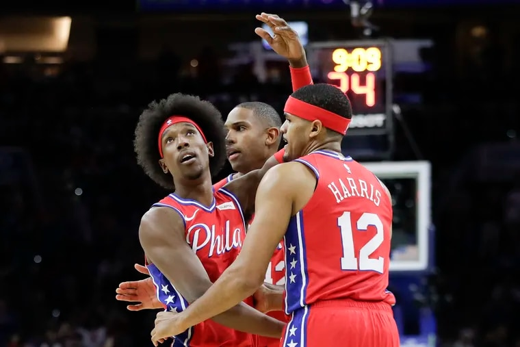 Josh Richardson (left) celebrating a three-pointer with Al Horford and Tobias Harris during a November game against the Miami Heat.