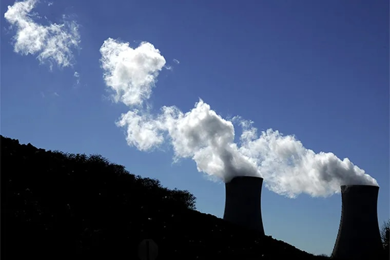 Clouds of condensed water vapor leave the cooling towers of the Limerick nuclear power plant in Pottstown Monday, November 18, 2013. CLEM MURRAY / Staff Photographer