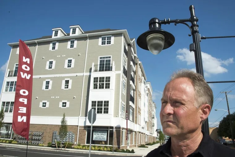 Mayor Randy Teague pauses by the new complex of apartments near the PATCO Speedline station May 31, 2017, one of the big changes along Haddon Avenue in Westmont that are good news for Haddon Township.