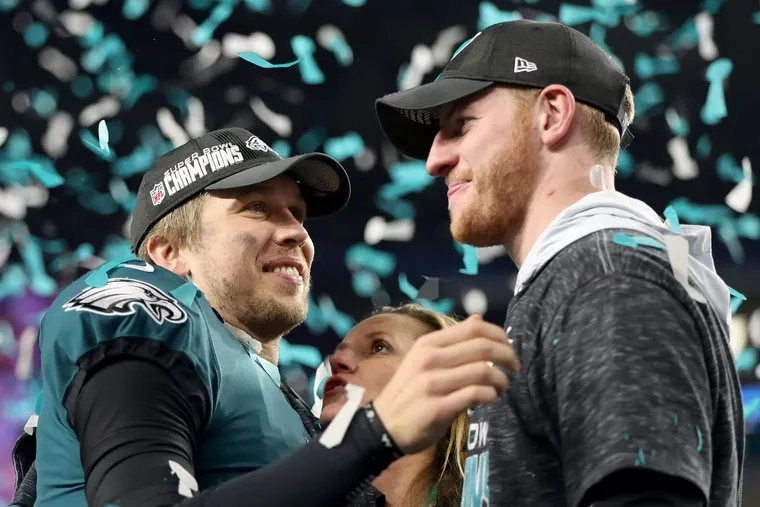 Nick Foles, left, is now with the Chicago Bears, a team that could be a destination for Carson Wentz, right, in a trade.