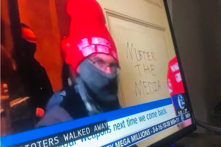 The FBI says this screen shot of TV news coverage, included in court filings, shows Donald Smith of Lindenwold moving through the Capitol as rioters stormed the building on  Jan. 6