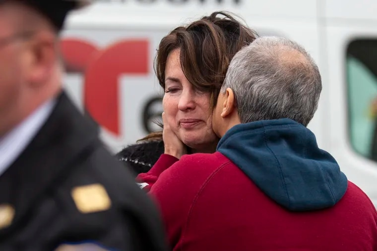 Mark Ingerman kisses his wife, Alla Sherman, at a Philadelphia Police news conference Dec. 13 about the crash that killed her mother, Yulia Sherman, as she walked with a shopping cart. The driver, Romualda Gulbiniene, was arrested Friday.