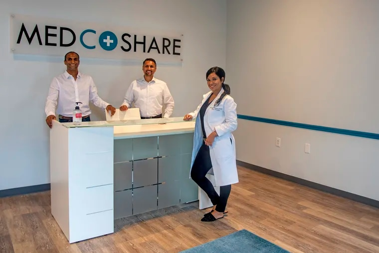 Cofounders Anthony Khan (left) and Ronak Vyas (center) poise in their new start-up Aug. 3, 2020, with registered nurse Marybell Rodriguez (right) of Blissful Aesthetics and Wellness. She is one of the first tenants in MedCoShare, their coworking space in Fishtown that's only for medical offices. Both she and her patients are required to wear masks at all times because of the COVID-19 pandemic, and all rooms are fully sanitized by a cleaning service between appointments, said Vyas.