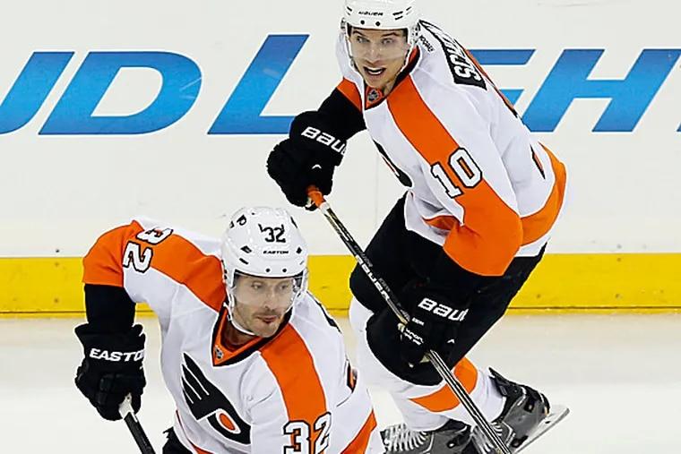 The Flyers' Mark Streit and Brayden Schenn. (Yong Kim/Staff Photographer)