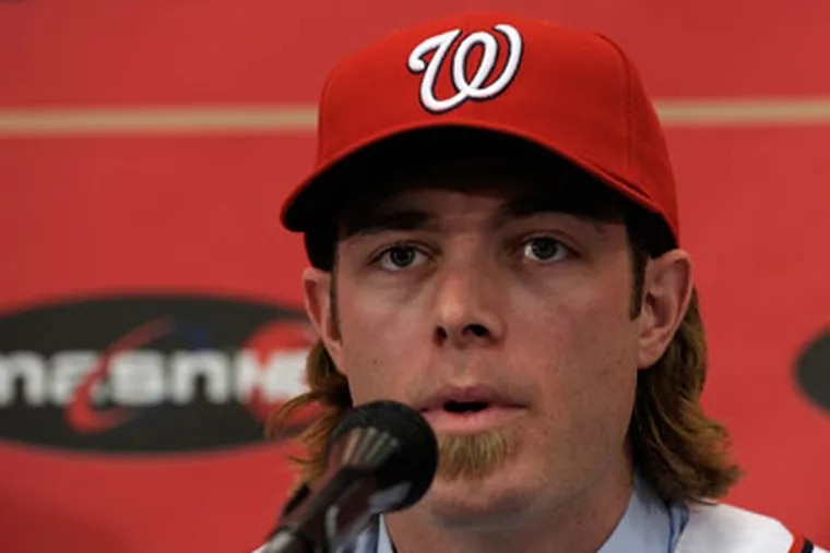 Jayson Werth was introduced as a member of the Nationals Wednesday. (AP Photo/Susan Walsh)