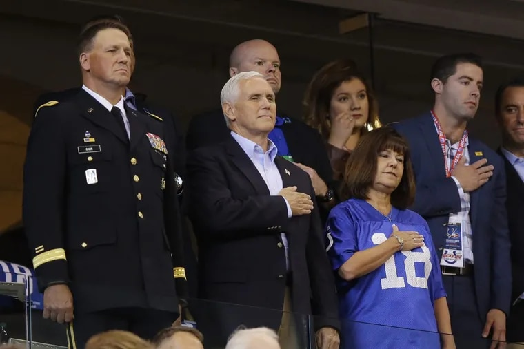 Vice President Mike Pence stands during the playing of the national anthem before an NFL football game between the Indianapolis Colts and the San Francisco 49ers.
