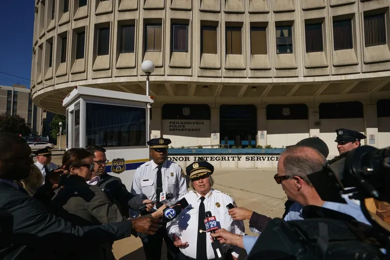 Acting Philadelphia Police Commissioner Christine M. Coulter (center).