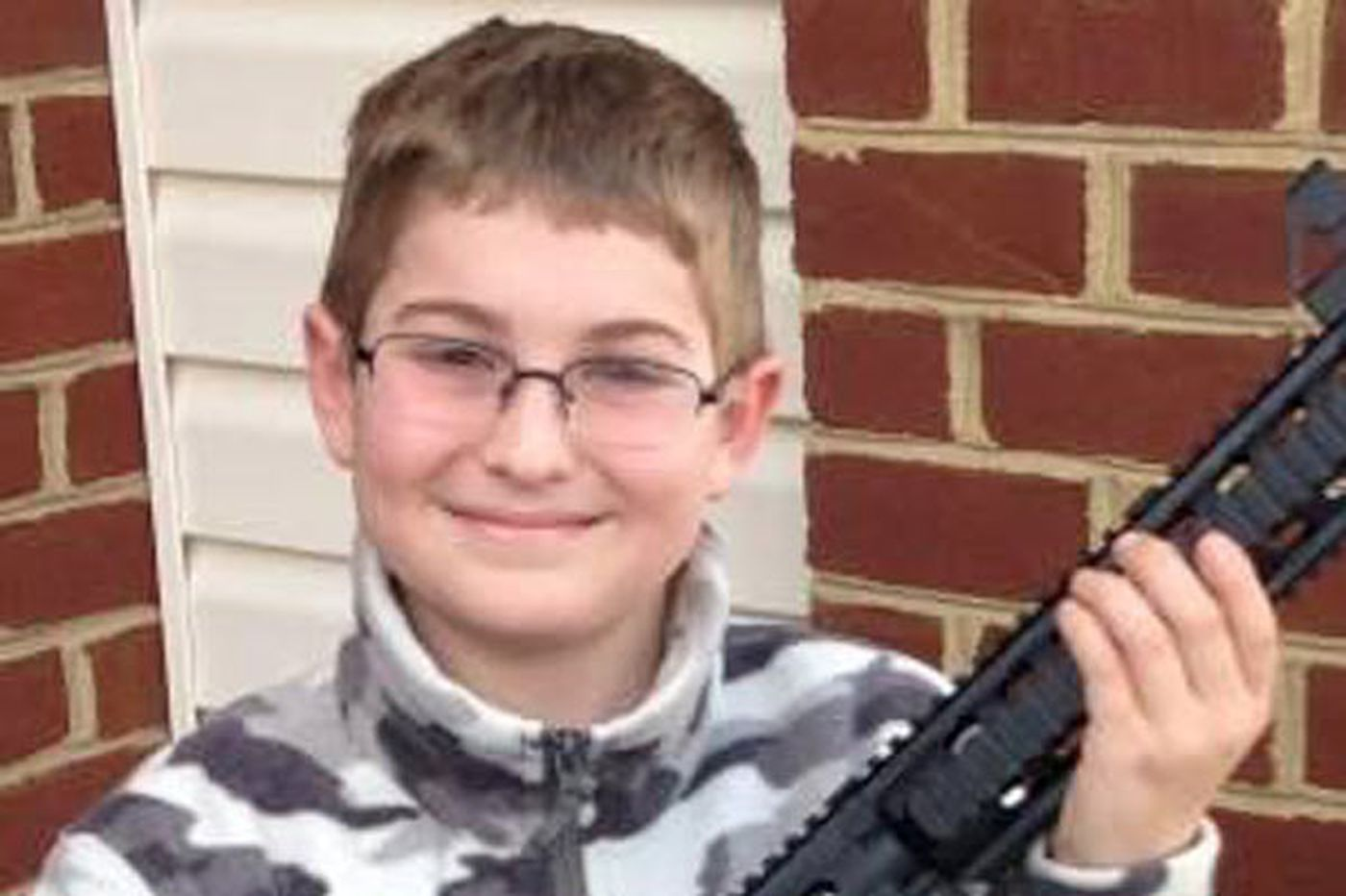 Election enraged man who posted Facebook pic of son with rifle