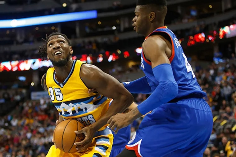 Denver Nuggets forward Kenneth Faried (35) looks to shoot against 76ers center Nerlens Noel (4) during the first half at Pepsi Center. (Chris Humphreys/USA Today)
