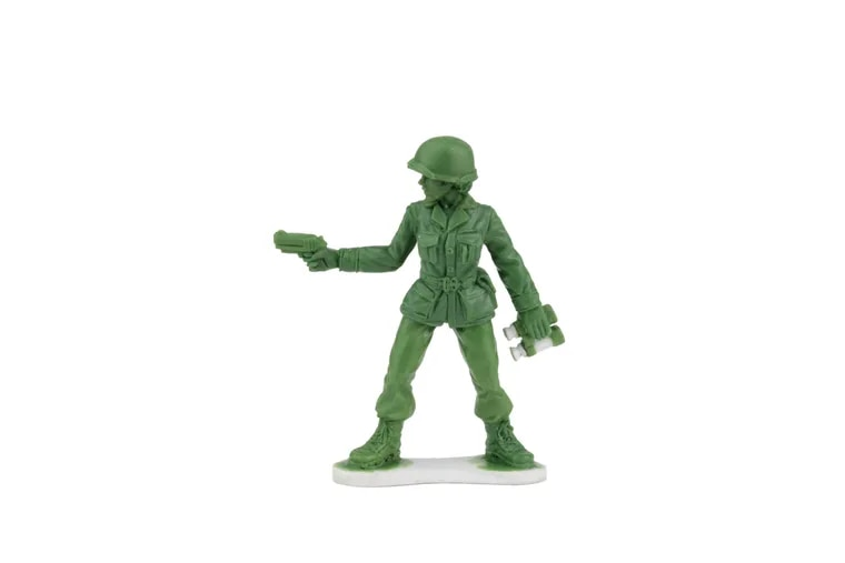 This prototype will eventually become a tiny, green, plastic Army woman who's holding a handgun and considered to be of a higher rank. The toy is in development by a Scranton company that responded to a 6-year-old girl's letter expressing her disappointment at not being able to find plastic Army women.