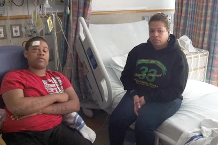 Montez Wilmer, 17, and his mother, Christina Turner-Johnson, in his room at Children's Hospital of Philadelphia. (Tom Gralish / Staff Photographer)