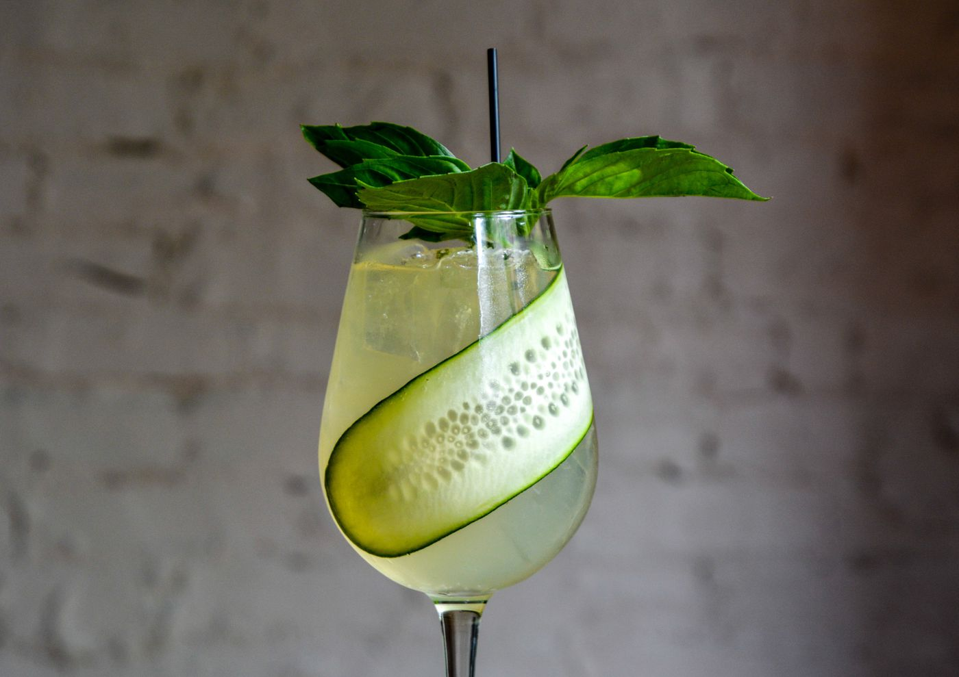 At Jamonera, find the Lincoln Club Cup, a drink that combines Lillet and earthy Bénédictine with muddled cucumber, orange, lime, and lemon. Finished with a thinly sliced cucumber and sprig of basil, the pale green drink emanates spring.
