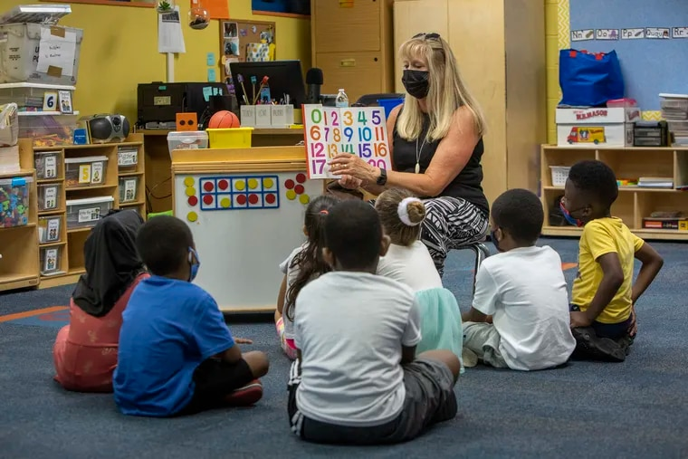 Teacher Donna Roth works with children in her classroom during a kindergarten enrichment program at Musselman Learning Center in Norristown. Nationwide, kindergarten enrollment declined last year because of the pandemic, which disrupted education and kept some parents from enrolling their children in early childhood educational experiences.