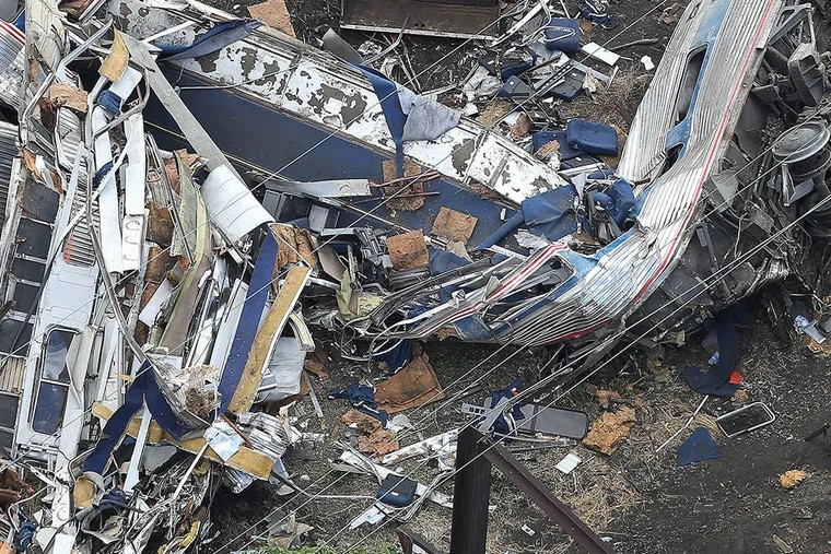 The remains of one of the rail cars from Amtrak Train 188 rest at the scene in Port Richmond on May 13, 2015. (DAVID MAIALETTI/Staff Photographer)