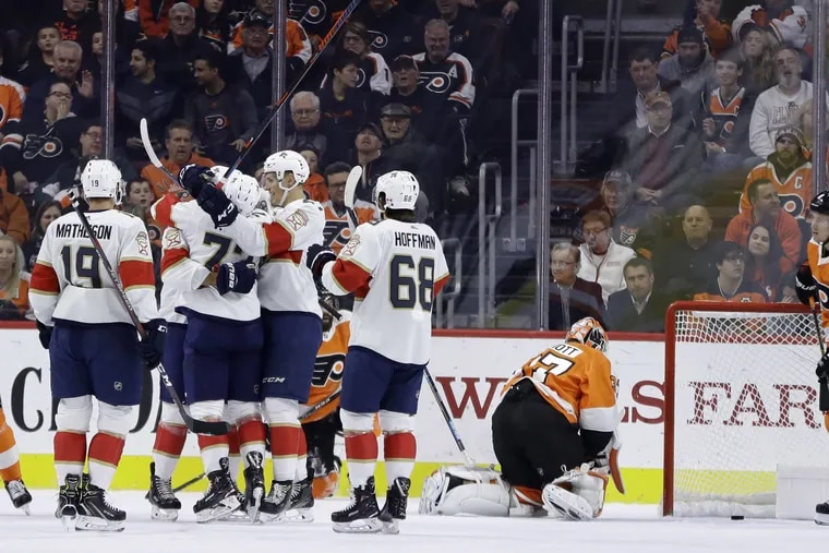 Florida players celebrate after a power-play goal by Aaron Ekblad gave the Panthers a 1-0 second-period lead Tuesday at the Wells Fargo Center.