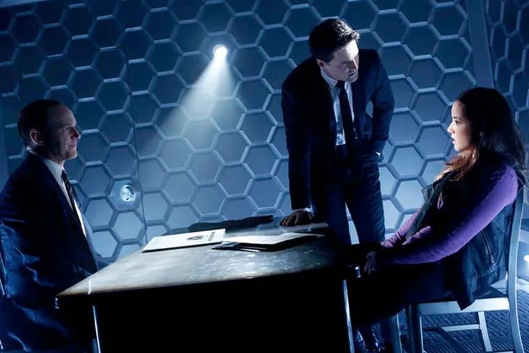 """Marvel's Agents of S.H.I.E.L.D."" on ABC features Clark Gregg (left), Brett Dalton, and Chloe Bennet: Specialized agents investigating strange phenomena. (JUSTIN LUBIN / ABC)"