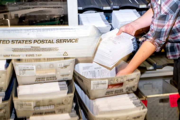 Mail ballots are sorted Thursday at the Chester County Government Services Center in West Chester, Pa.