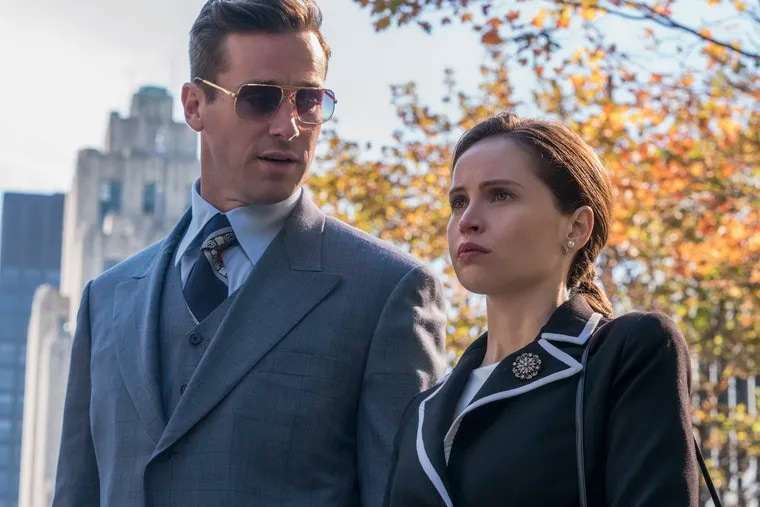 """In this image released by Focus Features, Armie Hammer portrays Marty Ginsburg, left, and Felicity Jones portrays Ruth Bader Ginsburg in a scene from """"On the Basis of Sex."""" (Jonathan Wenk/Focus Features via AP)"""