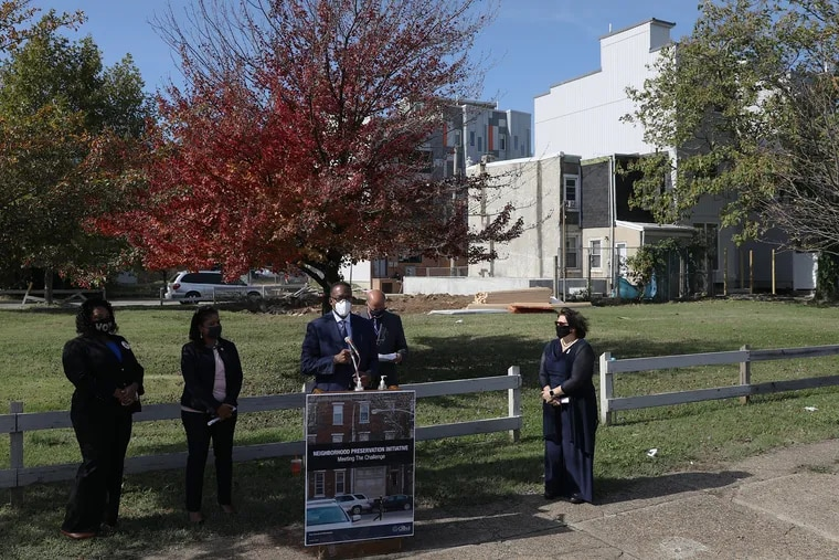 City Council President Darrell L. Clarke (center) speaks during a news conference at the site of a planned affordable housing development at Third and Berks Streets in North Philadelphia in 2020.