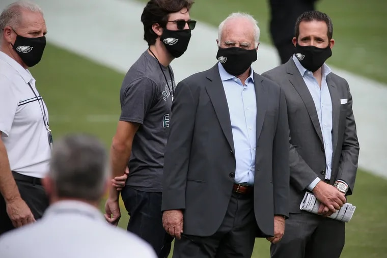 Eagles owner Jeffrey Lurie (second from right) and vice president Howie Roseman (right) have long prioritized offense in building the team's roster.