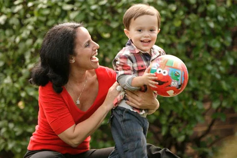 Shari Botwin and her 2-year-old son, Andrew, play outside their home in Narberth.  (Elizabeth Robertson/Staff Photographer)