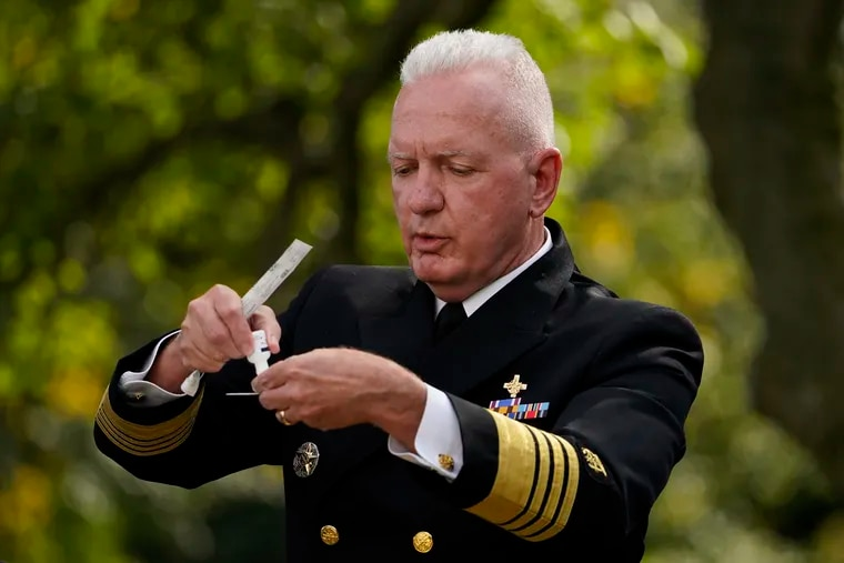 Adm. Brett Giroir, assistant secretary of Health and Human Services, demonstrates the rapid-result COVID-19 test the federal government will send to states during President Donald Trump's announcement of the testing plan in the Rose Garden of the White House, Monday, Sept. 28, 2020, in Washington. (AP Photo/Evan Vucci)