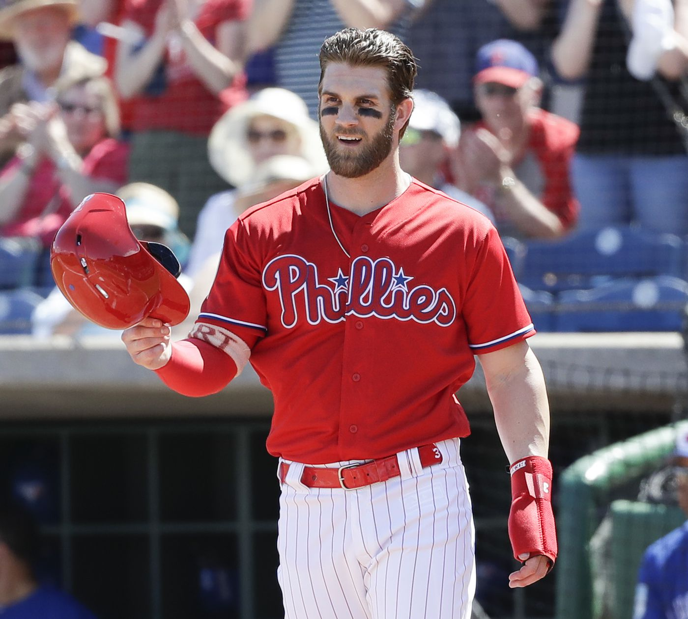 82ed0e5e2ee Bryce Harper salutes Rhys Hoskins after the latter homered against the Blue  Jays in a spring