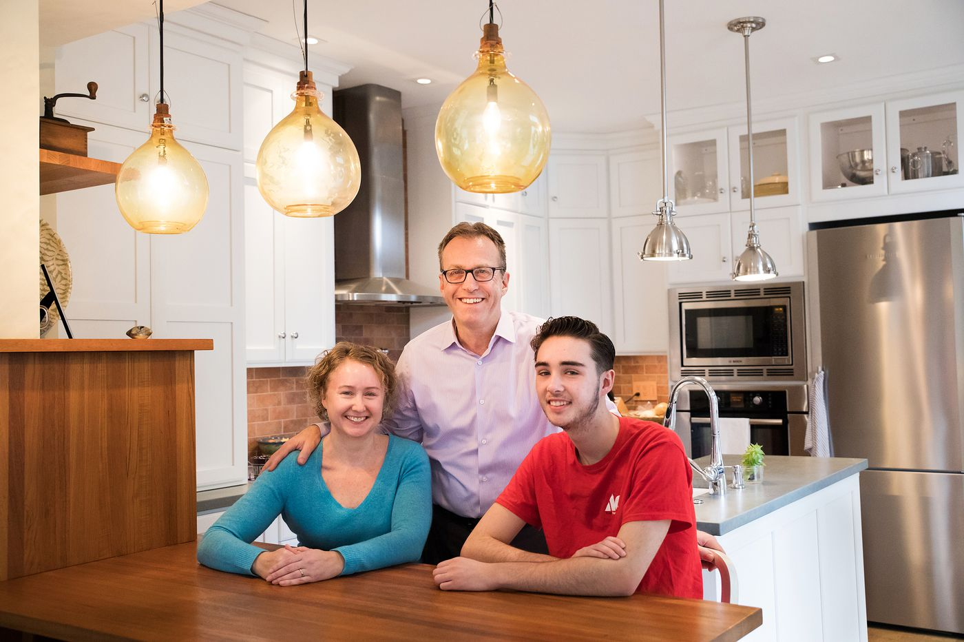 Fairmount rowhouse for blended family combines historical, modern, and sustainable