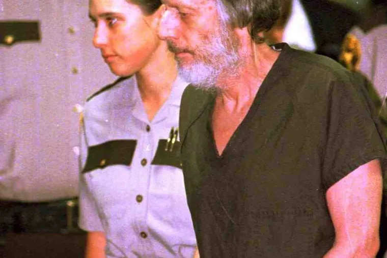 John E. du Pont being escorted from court in 1996. He died of natural causes.