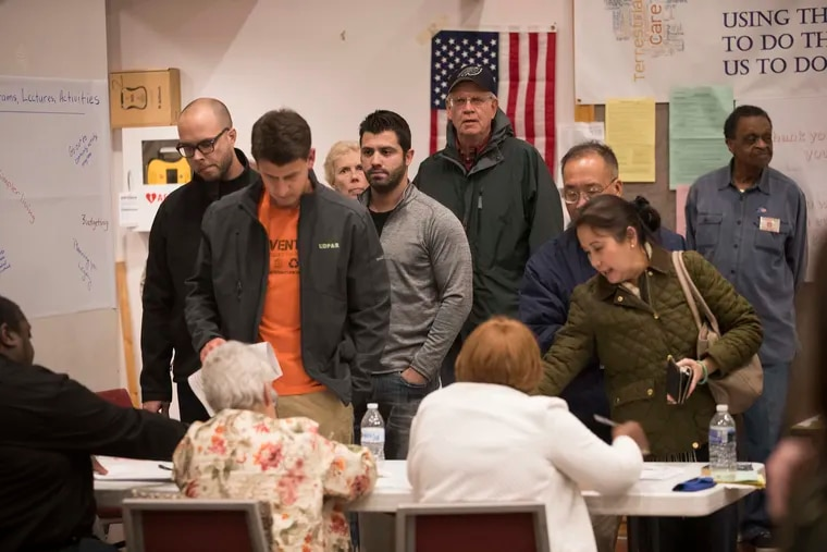 Voters sign in to vote at Trinity Episcopal Church in Ambler.