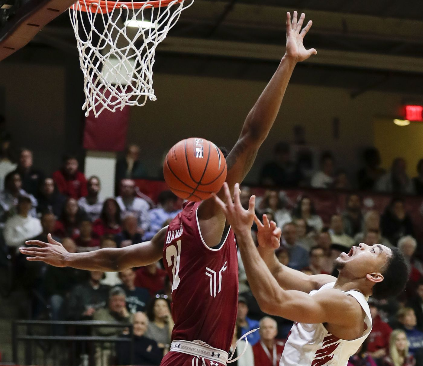 0399e6be858 Saint Joseph's guard Jared Bynum getting fouled after driving to the basket  against Temple forward Justyn