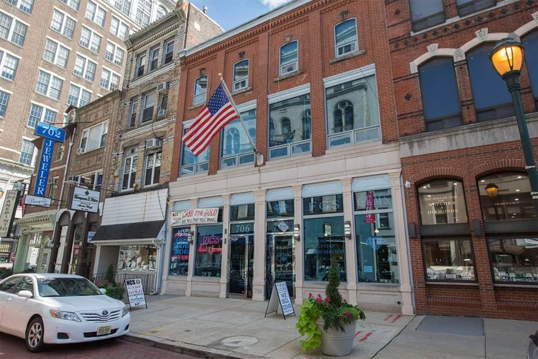 Five properties in the 700 block of Sansom Street would be demolished for a 16-story residential tower under the plan.