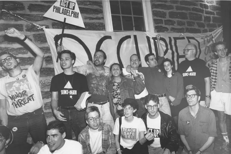 Occupation of nursing home building by ACT UP persons. Group chants on porch in front of occupied banner. October 5th, 1990. Chris Gardner / AP