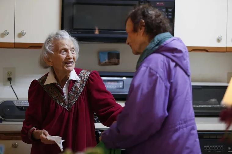 Loretta Katz, 85, (right) of Northeast Philadelphia, talks with Elizabeth Bleiman, 94, as she delivers Meals on Wheels to her in Northeast Philadelphia.