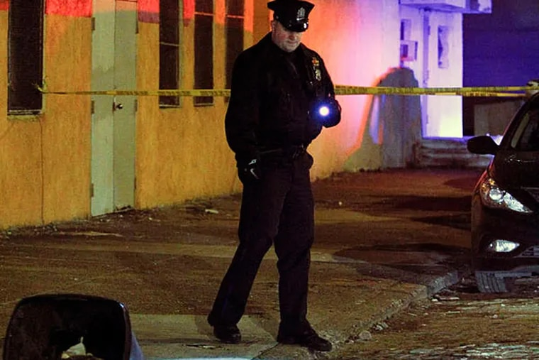 Police look for evidence on the 900 block of N. Front Street in the Northern Liberties section of Philadelphia on Sunday Jan. 19, 2013, after a woman was fatally wounded during a purse snatching. (For the Daily News/ Joseph Kaczmarek)