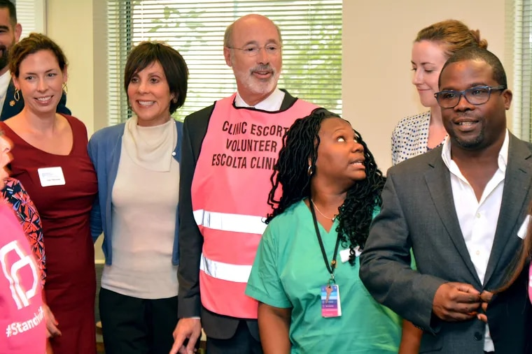 Planned Parenthood is planning to spend $1.5 million to help reelect Gov. Wolf. Here, the Democratic governor is seen visiting a Planned Parenthood facility in Philadelphia last year.