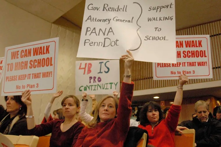 Among those holding signs opposing the Lower Merion district's busing plan are Elyse Seltzer (center) and Janet Long (left).
