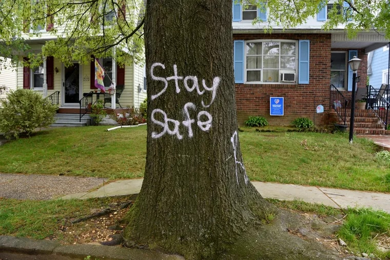 A spray painted message is left for the residents of East Cedar Avenue in Haddon Township, N.J.  May 6, 2020.