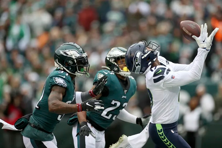 Seahawks wide receiver Malik Turner catches a 33-yard touchdown pass behind Eagles cornerback Jalen Mills and free safety Rodney McLeod in the first quarter.