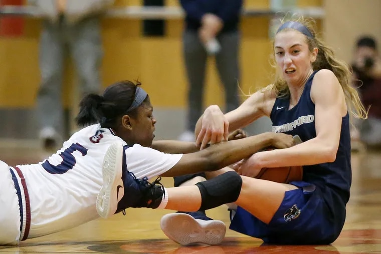 Spring-Ford's Lucy Olsen (right) and Cardinal O'Hara's Sydni Scott fight for the ball in a playoff game last season.